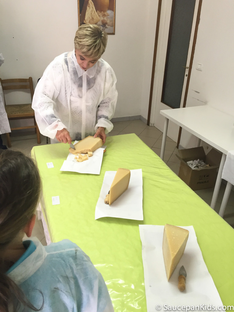 Tasting the 12 month, 22 months and 40 month old cheese - Saucepan Kids visiting a local dairy and exploring things for families to do in Emilia Romagna