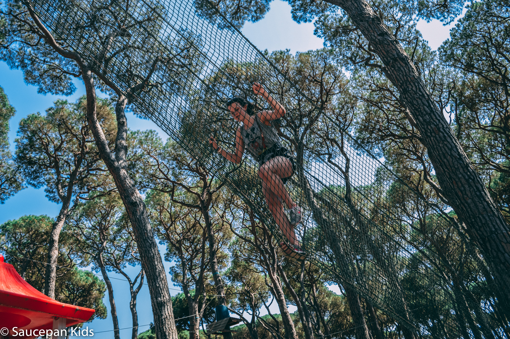 Saucepan Kids trying out the zip line at Parc Albatros - Canvas Holidays