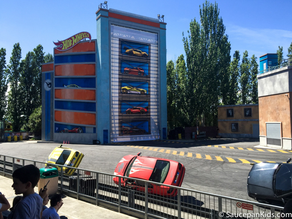 Watching the hot wheel car stunt show in Mirabilandia theme park - Things for families to do in Emilia-Romagna Italy - Saucepan Kids