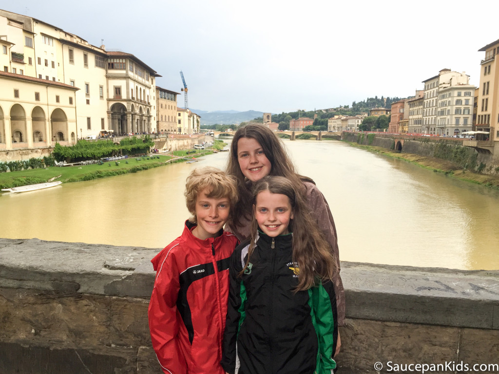 Saucepan Kids pose for a photo on the Ponte Vechio bridge over the Arno river in Florence, Italy
