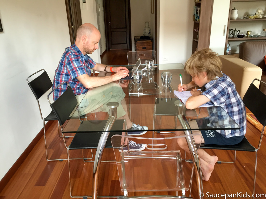 Saucepan Kids writing their travel journals in the Windows on Italy apartment in Florence, Italy