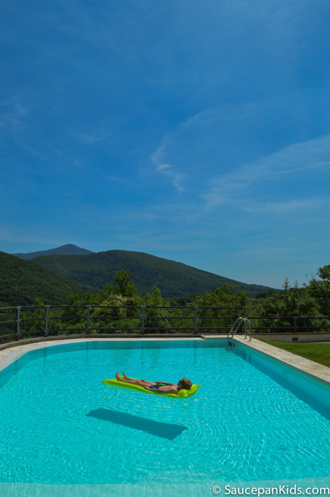 Saucepan Kids review Villa le Croci for Windows on Italy - Family Friendly places to stay in Tuscany - Fraser floating on the pool