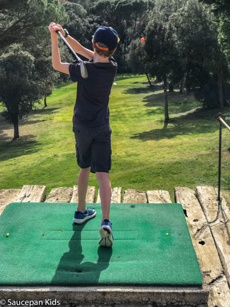 thing-to-Family Friendly things to do in Costa Brava with Saucepan Kids - Catalonia - Spain - A family golf lesson at Golf Lloret in Lloret del Mar - perfecting the swing