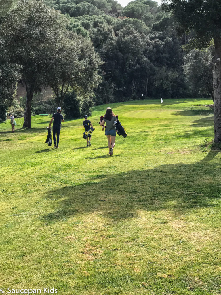 thing-to-Family Friendly things to do in Costa Brava with Saucepan Kids - Catalonia - Spain - A family golf lesson at Golf Lloret in Lloret del Mar - walking the fairway