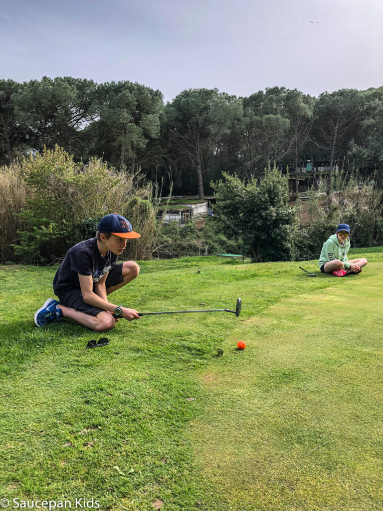thing-to-Family Friendly things to do in Costa Brava with Saucepan Kids - Catalonia - Spain - A family golf lesson at Golf Lloret in Lloret del Mar - putting into practice all we learned