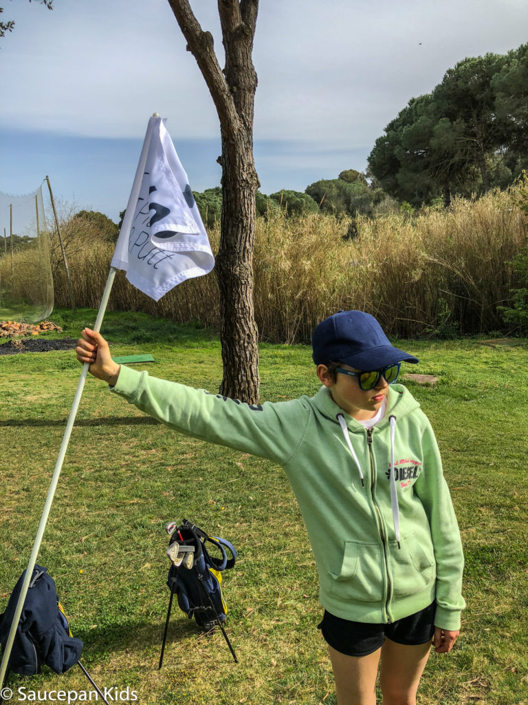 thing-to-Family Friendly things to do in Costa Brava with Saucepan Kids - Catalonia - Spain - A family golf lesson at Golf Lloret in Lloret del Mar - concentrating on the green 2