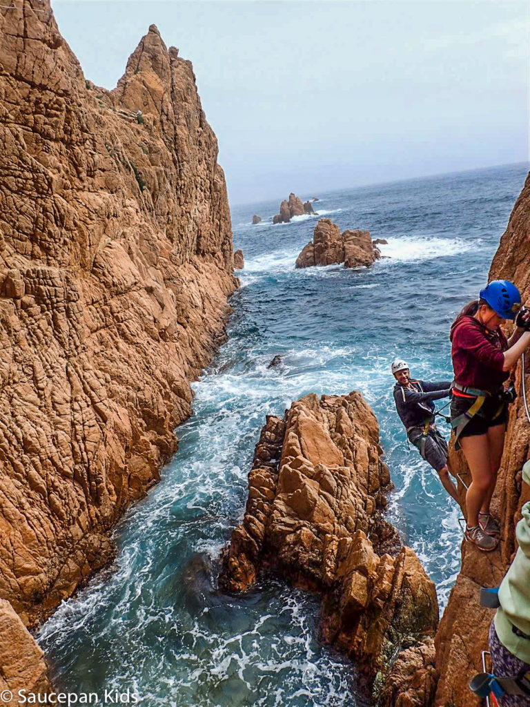 Family Friendly things to do in Costa Brava with Saucepan Kids - Catalonia - Spain - A family guided tour of Via Ferrata Cala Del Moli Sant Feliu - crossing a rope bridge - top things to do for kids in Spain
