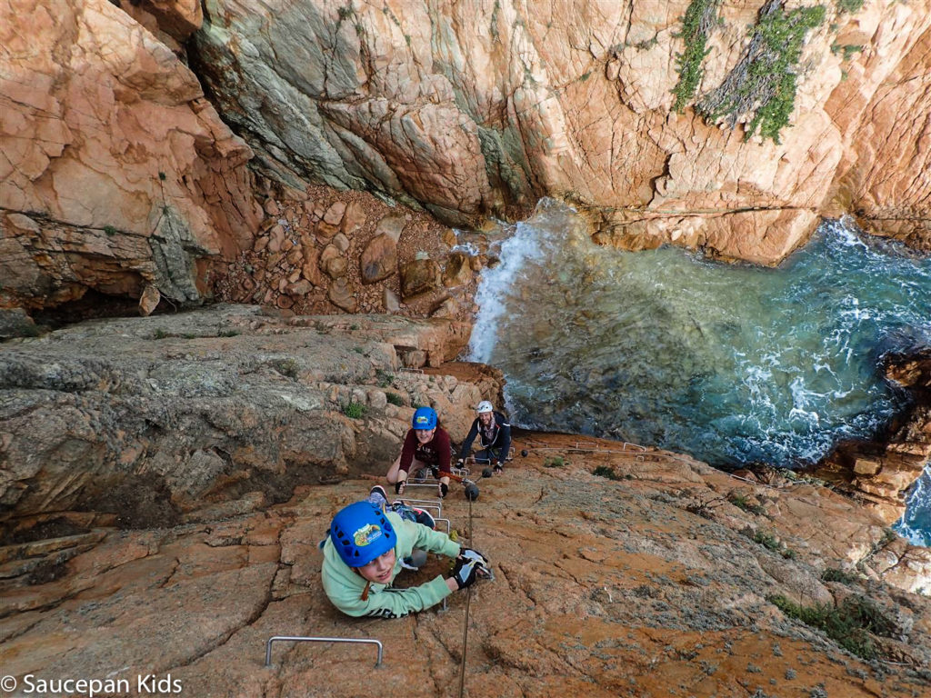 Family Friendly things to do in Costa Brava with Saucepan Kids - Catalonia - Spain - A family guided tour of Via Ferrata Cala Del Moli Sant Feliu - crossing a rope bridge - top things to do for kids in Spain - nearly at the top