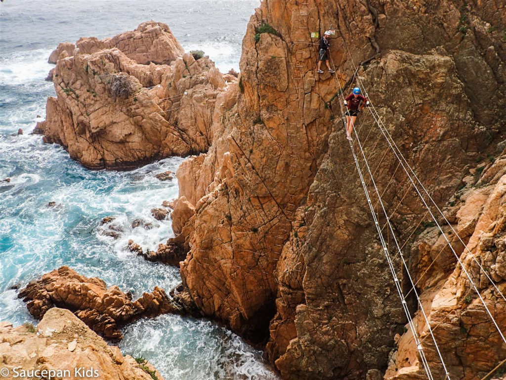 Family Friendly things to do in Costa Brava with Saucepan Kids - Catalonia - Spain - A family guided tour of Via Ferrata Cala Del Moli Sant Feliu - crossing a rope bridge - top things to do for kids in Spain - another rope bridge