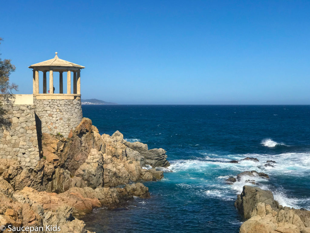 Family Friendly things to do in Costa Brava with Saucepan Kids - Catalonia - Spain - top things to do for kids in Spain - A family walk along the coastal paths in Costa Brava - Platja d'Aro coastal walk picture postcard